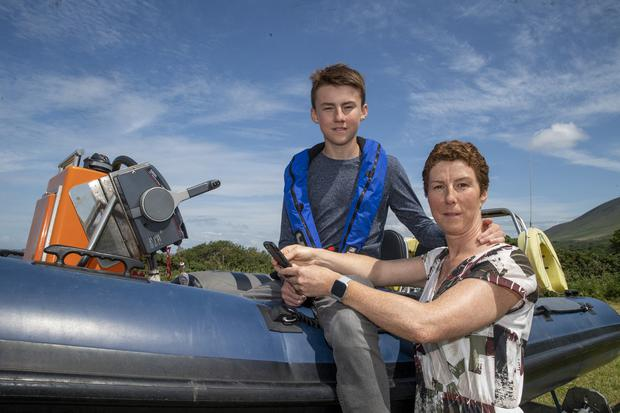 Tomás Deane pictured at home with his mum Noirin on his RIB in West Kerry (Photo: Domnick Walsh)
