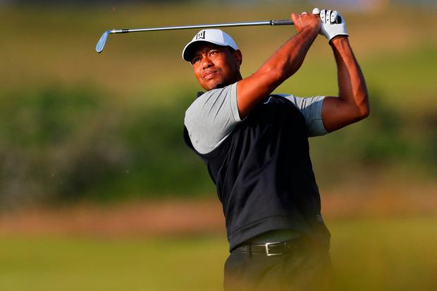 Tiger Woods plays a shot during a practice round at Portrush ahead of the British Open which starts tomorrow. Photo: Kevin C. Cox/Getty Images
