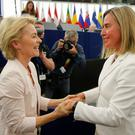 Vote winner: Newly elected EU Commission president Ursula von der Leyen is congratulated by chief of foreign affairs Federica Mogherin. Photo: Reuters