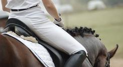 The woman was injured when she fell from a horse. Stock image