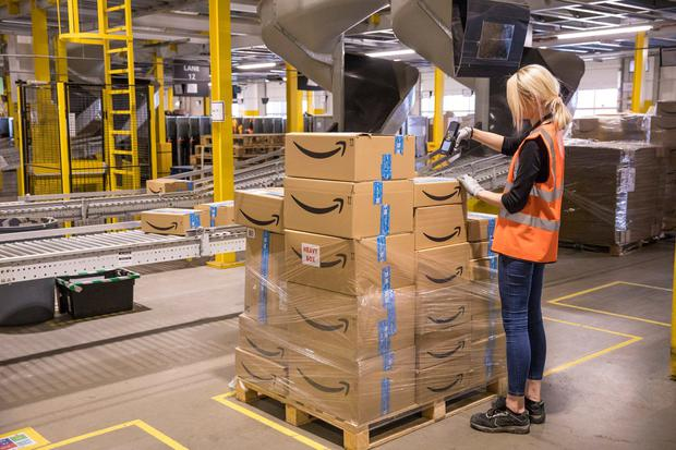 An employee checks packages at the Amazon.com Inc. fulfilment centre. Photo: Jason Alden/Bloomberg