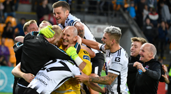 Gary Rogers of Dundalk, centre, celebrates with team-mates following the UEFA Champions League First Qualifying Round 2nd Leg match between Riga and Dundalk at Skonto Stadium in Riga, Latvia. Photo by Roman Koksarov/Sportsfile