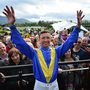 Jockey Frankie Dettori with racegoers during day 3 of the Killarney Racing Festival at Killarney Racecourse in Kerry. Photo by David Fitzgerald/Sportsfile