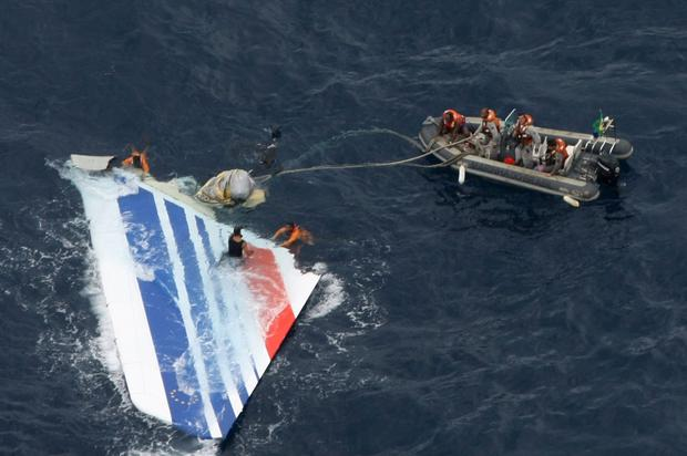 Debris: Part of the doomed Airbus 330 is picked up by a Brazilian navy team after the crash. Photo: REUTERS