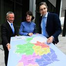 Paul Reid HSE CEO, Laura Magahy, Executive Director Slaintecare and Minister for Health Simon Harris TD, during an announcement on Slaintecare at the Department of Health, Block 1, Miesian Plaza in Dublin's City Centre. Photo: Gareth Chaney, Collins