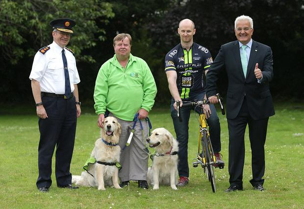 From left to right, Garda Commissioner, Drew Harris, Nick Palmer, Irish Guide Dogs for the blind, with Riley and Ellie, Garda Phil Gleeson, and Spanish ambassador to Ireland, Mr IIdefonso Castro at the launch of the Garda Tour de Force Charity Cycle in aid of the Irish Guide dogs for the blind at the Spanish embassy in Dublin. Photo: Damien Eagers/INM