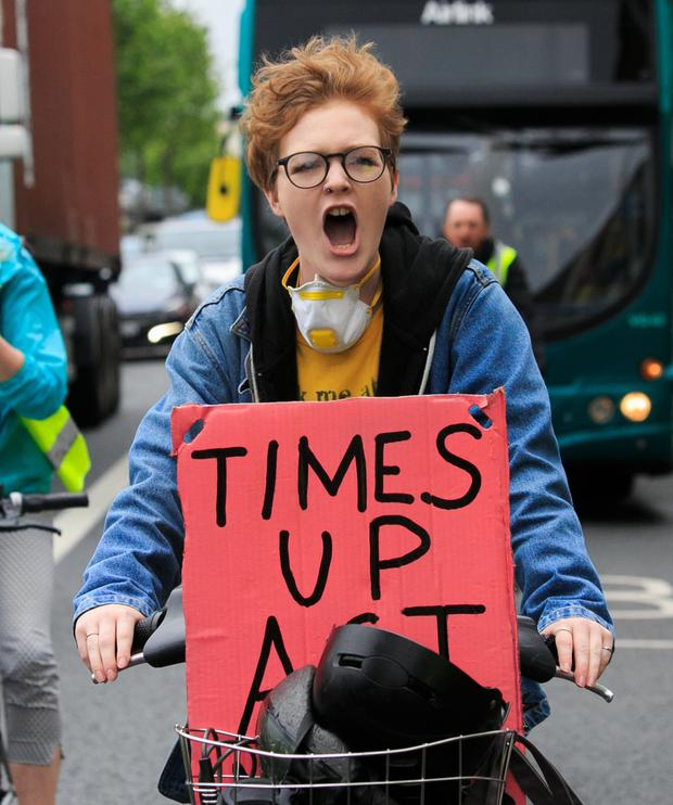 Pedal power: Extinction Rebellion activist Leontien Friel Darrell, from Tipperary, during a slow cycle from Heuston Station to the 3Arena. Photo: Gareth Chaney, Collins
