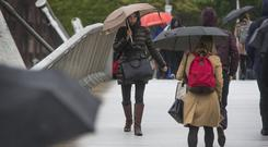 Rainy weather last month was blamed for a spending slump. Photo: Colin O'Riordan