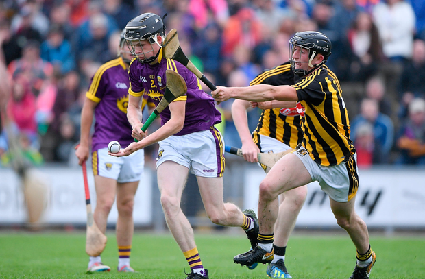 Wexford's Cian Fitzhenry in action against Mikey Butler of Kilkenny. Photo: Matt Browne/Sportsfile
