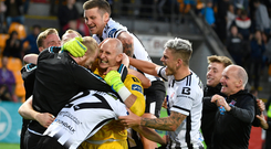 Gary Rogers, centre, celebrates with his Dundalk team-mates following the match. Photo: Roman Koksarov/Sportsfile
