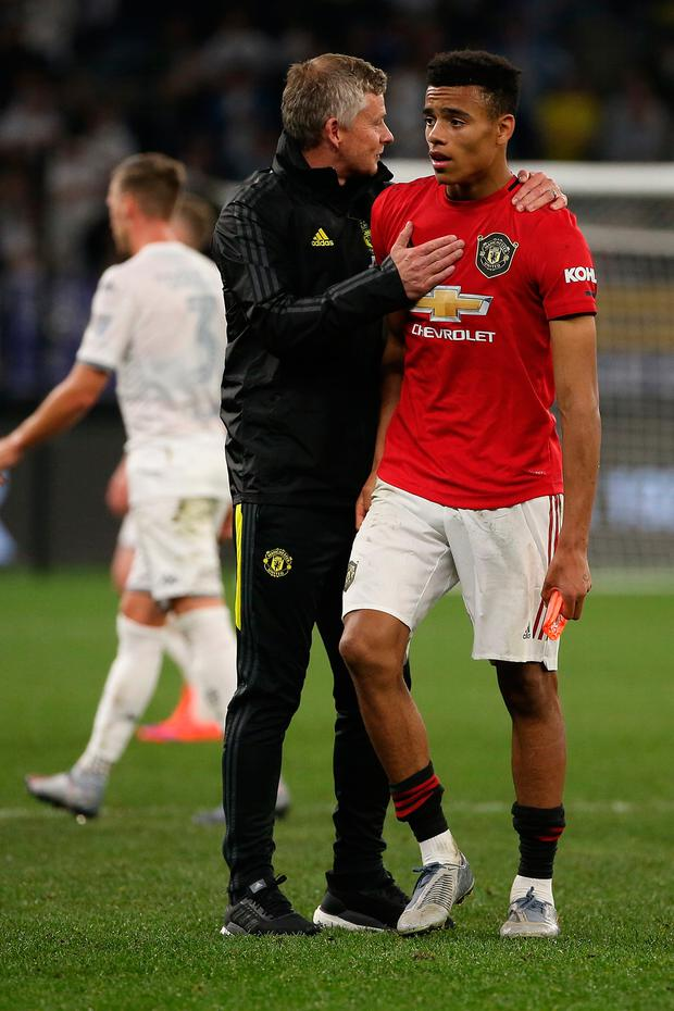 Ole Gunnar Solskjaer manager of Manchester United talks with Mason Greenwood during half-time of the pre-season friendly win over Leeds United at the Optus Stadium in Perth, Australia. Photo: Paul Kane/Getty Images