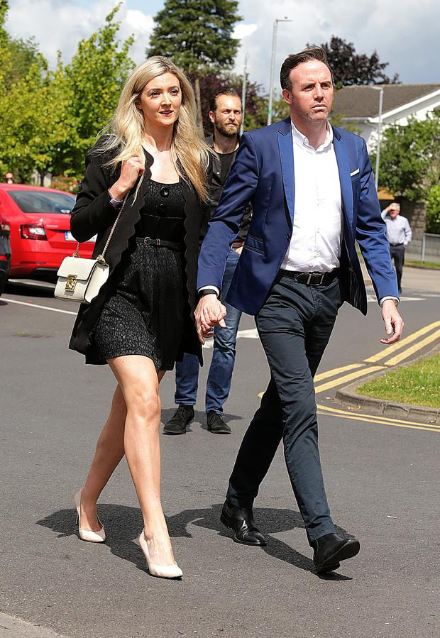 18/7/2019, Jenny Dixon and her partner Tom Neville, TD arrive at the funeral of Karl Shields at the Church of Our Lady Mother of the Cross in Castleknock. Picture credit; Damien Eagers / INM
