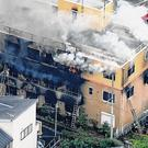 Terror: Smoke billows from a three-storey building of Kyoto Animation in western Japan yesterday. Photo: Kyodo News, via AP