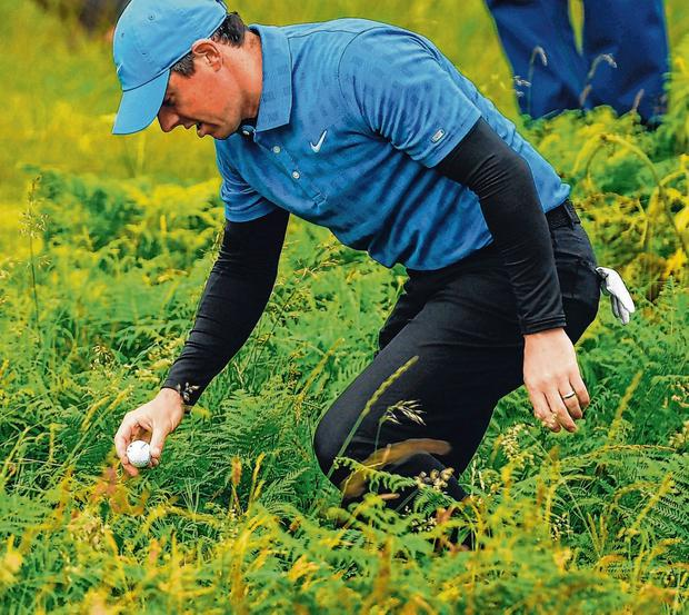 Rory McIlroy finds his ball on the 1st hole at Portrush. Photo: Ramsey Cardy/Sportsfile