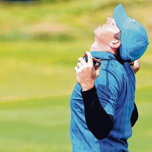 An exasperated Rory McIlroy reacts after a double-bogie on the 16th. Photo: David Davies/PA