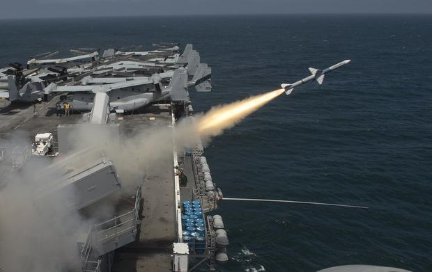A Sea Sparrow (RIM-7P) missile is launched from the amphibious assault ship USS Boxer (LHD 4) during a missile firing exercise in the Pacific.