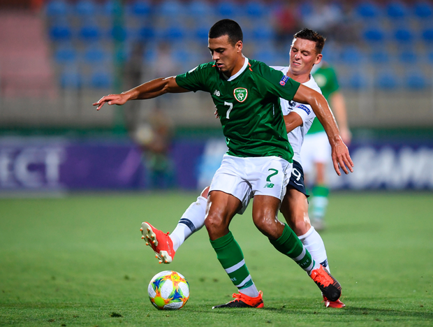 Ali Reghba of Ireland and Alexis Flips of France battle for possession. Photo: Sportsfile