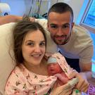 Happy family: Michael Duffy with partner Emily McCarron and their newborn baby boy Eli Michael