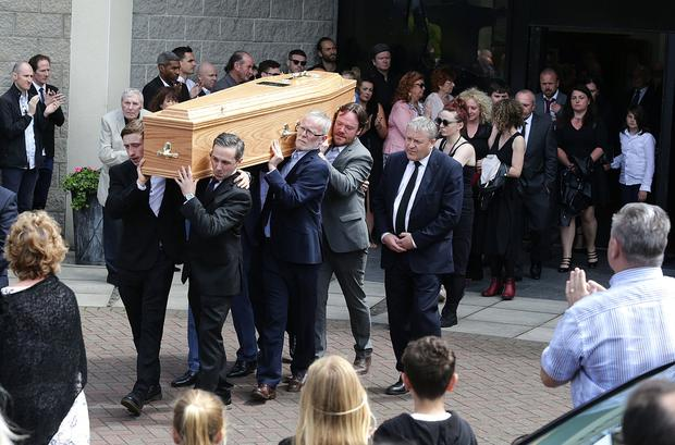 Paying their respects: The coffin is carried from the Our Lady Mother of the Church in Castleknock, Dublin, after the funeral of Karl Shiels. PHOTOS: DAMIEN EAGERS and COLIN KEEGAN
