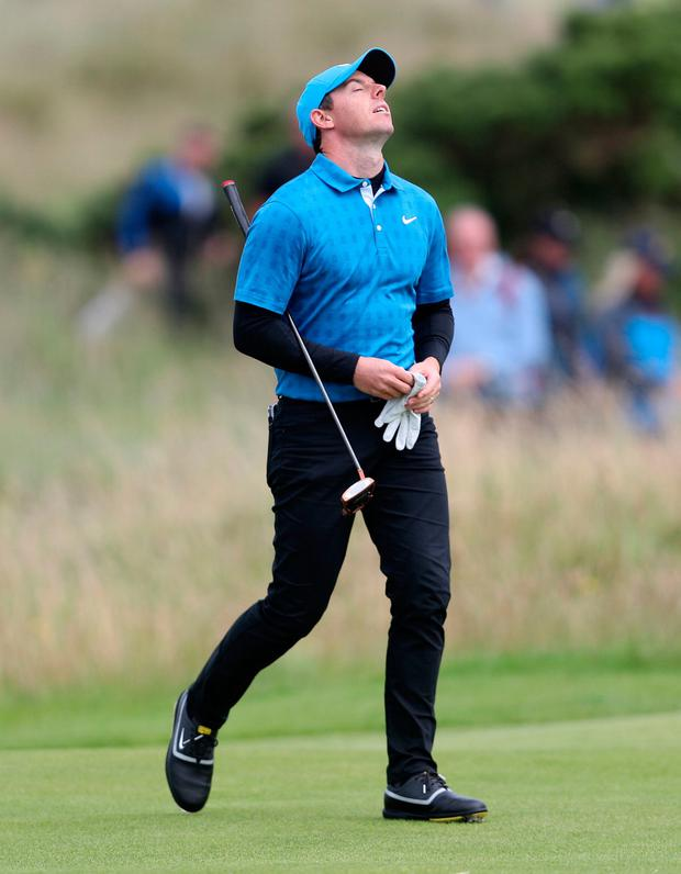 A day to forget: Rory at the 17th. Photos: Ramsey Cardey/Gerry Mooney