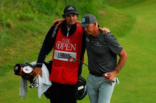 Tom Lehman of the United States walks off the 18th with his caddie at Royal Portrush Golf Club