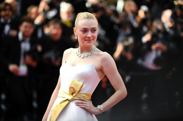 US actress Dakota Fanning poses as she arrives for the screening of the film