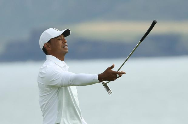 Tiger Woods of the United States throws his club in the air in frustration on the 5th green during the second round of the British Open Golf Championships at Royal Portrush in Northern Ireland, Friday, July 19, 2019.(AP Photo/Peter Morrison)
