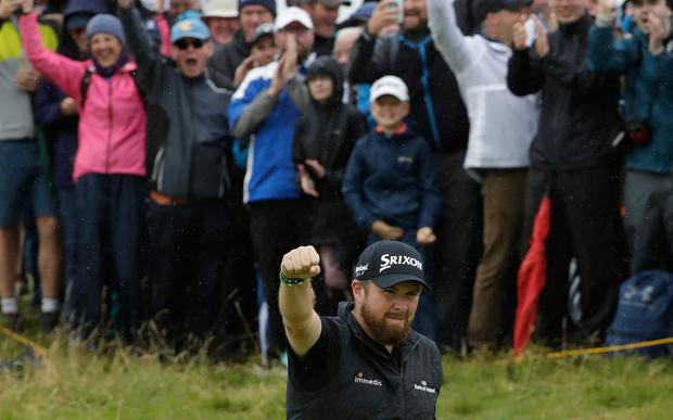 Ireland's Shane Lowry celebrates after he birdies the 10th hole during the second round of the British Open Golf Championships at Royal Portrush in Northern Ireland, Friday, July 19, 2019.(AP Photo/Matt Dunham)