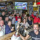Willie Gregg and pals in the Harbour Bar in Portrush, Co Antrim. Photo: Kyran O'Brien