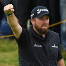 Putter there: Shane Lowry salutes the crowd after sinking a long putt on the 10th green yesterday. Photo: Getty Images