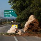 Rocks block part of a road following an earthquake in Aspropirgos, near Athens, Greece, July 19, 2019. REUTERS/Giorgos Moutafis