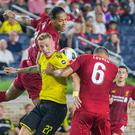 Liverpool defender Virgil van Dijk (4) heads the ball over Borussia Dortmund forward Marius Wolf (27) in the second half of a preseason preparation soccer match at Notre Dame. Mandatory Credit: Trevor Ruszkowski-USA TODAY Sports