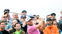 Graeme McDowell of Northern Ireland plays a tee shot from the 15th tee box