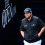 Shane Lowry of Ireland walks out to the 1st tee