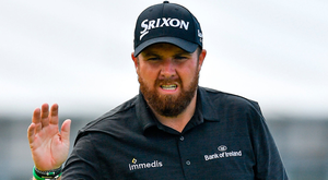 Shane Lowry of Ireland acknowledges the gallery after a putt on the 1st green