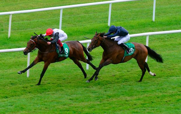 Star Catcher and Frankie Dettori (left) win the Kerrygold Irish Oaks at Curragh Racecourse