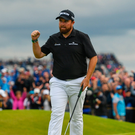 Shane Lowry of Ireland celebrates after a birdie putt on the 15th green