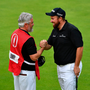 Shane Lowry of Ireland celebrates with his caddy Brian Martin on the 18th green