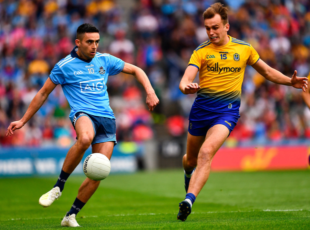 Niall Scully of Dublin in action against Enda Smith of Roscommon. Photo: Ray McManus/Sportsfile