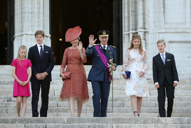 Belgium's King Philippe, Queen Mathilde and their children Princess Eleonore, Prince Gabriel, Crown Princess Elisabeth and Prince Emmanuel leave the Sainte-Gudule cathedral after a religious service (Te Deum) on Belgian national day in Brussels, Belgium July 21, 2019. REUTERS/Yves Herman