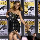 Natalie Portman greets fans as she walks on stage during the