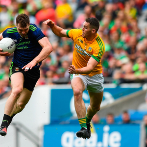 Brendan Harrison of Mayo in action against Bryan Menton of Meath