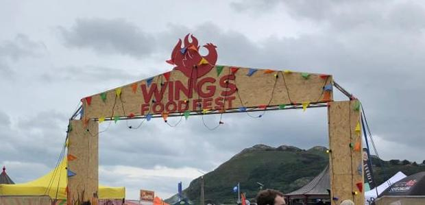 The large signage for 'Wings Food Fest' fell over in high winds (Photo: Paul Quinn/Twitter)
