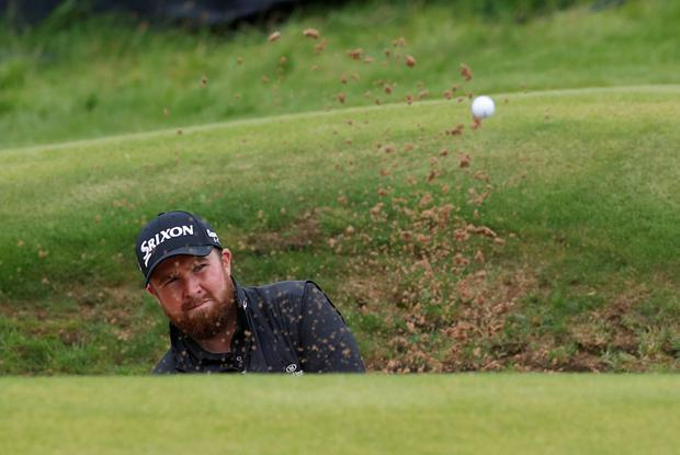 Golf - The 148th Open Championship - Royal Portrush Golf Club, Portrush, Northern Ireland - July 21, 2019 Republic of Ireland's Shane Lowry plays out of a bunker on the 13th hole during the final round REUTERS/Paul Childs