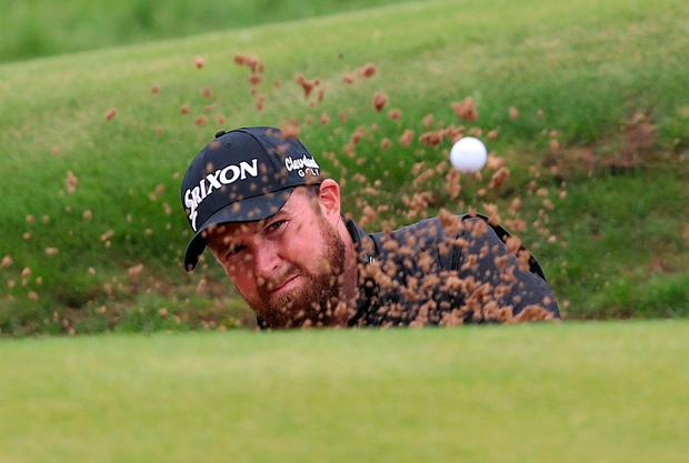Republic Of Ireland's Shane Lowry hits from the bunker on the 13th during day four of The Open Championship 2019 at Royal Portrush Golf Club.David Davies/PA Wire