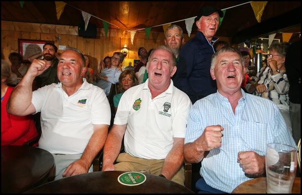 Thomas Newman from Clara and cousins Pat and Billy Clavin from Rahan cheering on Shane Lowry during the final day of the British Open at Esker Hills Golf Club in Offaly. Pic Steve Humphreys