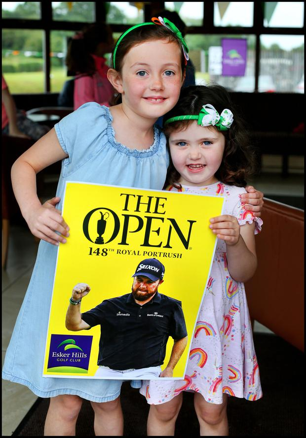 Sisters Isabel Farrell (7) and Jane Farrell (4) from Tullamore Offaly cheering on Shane Lowry during the final day of the British Open at Esker Hills Golf Club in Offaly. Pic Steve Humphreys 21st July 2019