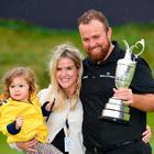 Open Champion Shane Lowry of Ireland celebrates with the Claret Jug, wife Wendy and daughter Iris on the 18th green during the final round of the 148th Open Championship held on the Dunluce Links at Royal Portrush Golf Club on July 21, 2019 in Portrush, Co. Antrim. (Photo by Stuart Franklin/Getty Images)