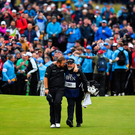 Shane Lowry of Ireland celebrates with caddy Brian Martin as they walk onto the 18th green on their way to winning The Open Championship on Day Four of the 148th Open Championship at Royal Portrush, Co Antrim. Photo by Brendan Moran/Sportsfile Photo by Brendan Moran/Sportsfile