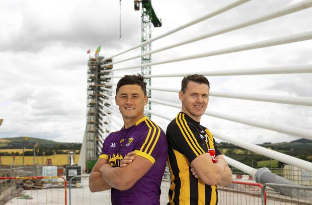 Meeting in the middle: TJ Reid of Kilkenny and Wexford's Lee Chin get together on the Rose Fitzgerald Kennedy Bridge after the final section of the 900 metre-long, 230 metre-high crossing was put in place. Photo: Mary Browne
